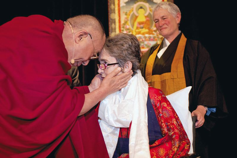 Photo Credit: COURTESY OF POWFEST - Part of POWFest, after an accident, Dr. Grace Drammann (with Dalai Lama) turned to her Buddhist spirituality, the subject of 'States of Grace.'