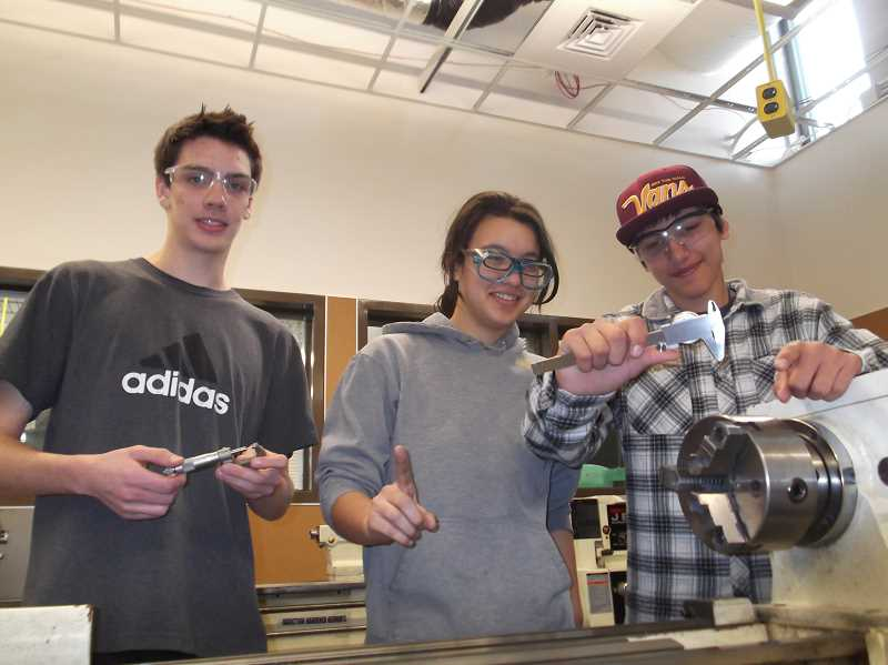 CONTRIBUTED PHOTO - Josh Gosnell, Taylor Walton and Edward Swinson used manufacturing skills learned at Sandy High School to win Clackamas Community College credit vouchers.