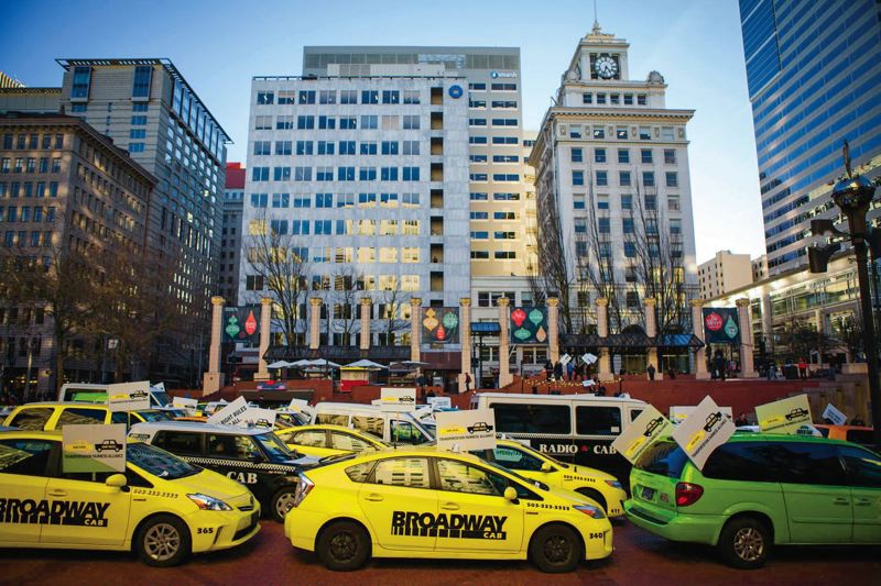 TRIBUNE FILE PHOTO - Dozens of off-duty taxis packed Pioneer Courthouse Square to protest Uber at a Jan. 13 demonstration.
