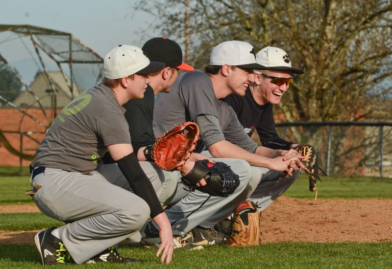 JOHN WILLIAM HOWARD - Members of the 2015 pitching staff share a laugh during practice last week. The Lions' pitching should be the key to their playoff run.