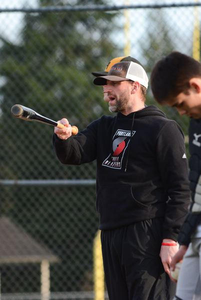 JOHN WILLIAM HOWARD - Jeff Timmons directs players during practice last week, taking advantage of the clear weather to get time on the field before the season begins.