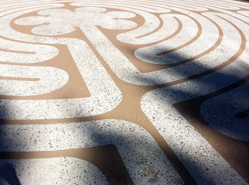 CONTRIBUTED PHOTO - Shibley has designed numerous labyrinths in civic, academic and religious settings. This labyrinth is painted on concrete at a private residence.