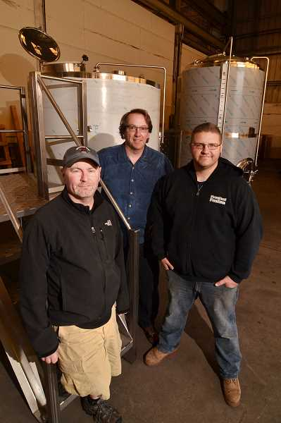 TIDINGS PHOTO: VERN UYETAKE - Tim Hohl has dreamed of opening his own brewery since he first started brewing in his garage 20 years ago. Now, with the help of Dave Fleming and Colin Preston, the dream will become reality when Coin Toss Brewing opens in Oregon City this summer.