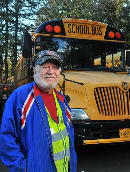 REVIEW PHOTO: VERN UYETAKE - School bus driver Bernie Cohen has long been fascinated with transportation, especially trains. He owns a model steam engine and regularly sports a classic train engineers cap.
