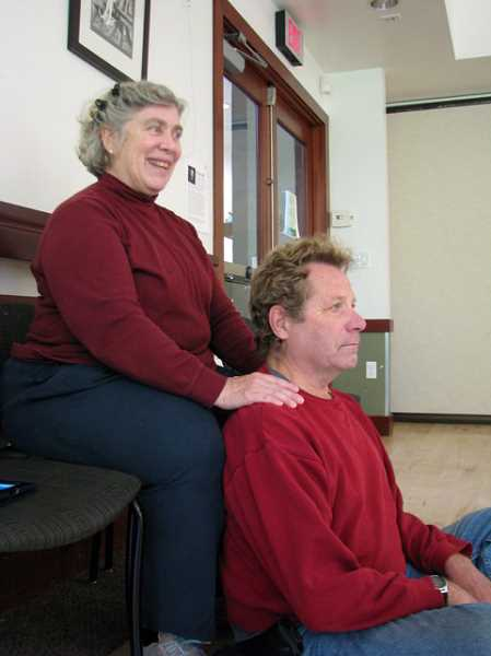 SUBMITTED PHOTO - Volunteer kiatsu practitioner Karen Lewis uses kiatsu to relieve stress in Tom Bradys neck.