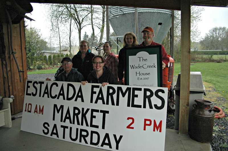 ESTACADA NEWS PHOTO: ISABEL GAUTSCHI - The Estacada Farmers Market has moved to the Wade Creek House. Pictured, back row from left: Joyce Wright, Estacada Farmers Market treasurer, Tonya Buus, market secretary and Becky and Bill McFarland, owners of Wade Creek House. Front row: Skip Heberden, market board member and Kathleen Leone, market president.