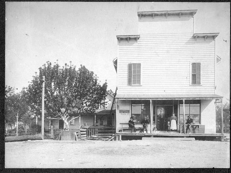PHOTO FROM TIGARD PUBLIC LIBRARYS LOCAL HISTORY COLLECTION - This 1905 photo shows Wilson Tigard's son Charles F. Tigard and family standing in front of the town's post office. The town was named Tigardville by Charles, though that name was later shortened to 'Tigard.'