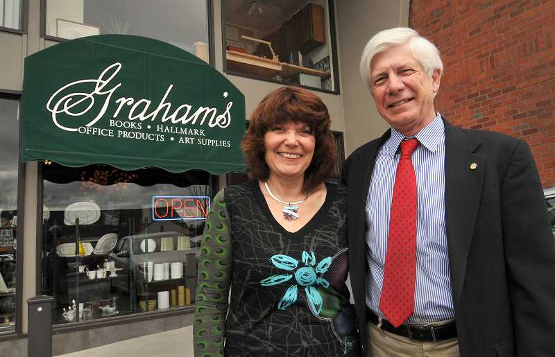 REVIEW PHOTO: VERN UYETAKE - Paul and teri Graham stand outside Grahams Book & Stationery on Second Street in Lake Oswego, where the shop has been located since the 1960s.