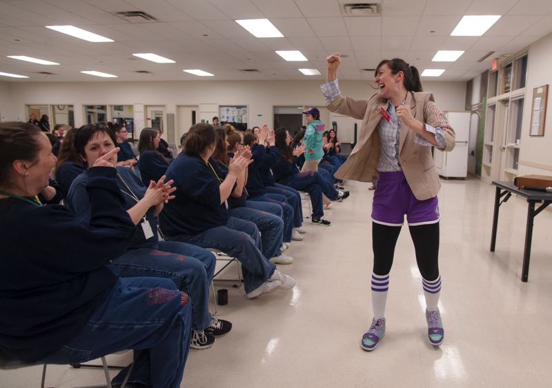 SPOKESMAN PHOTO: JOSH KULLA - Hand2Mouth cast member Julie Hammond gets motivational with Coffee Creek Correctional Facility inmates during the theater groups recent performance at the Wilsonville prison.