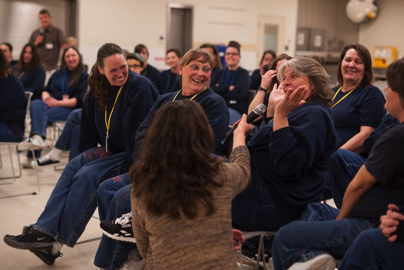 SPOKESMAN PHOTO: JOSH KULLA - Coffee Creek Correctional Facility inmates share their own pep talks during the Hand2Mouth theater group's recent performance at the Wilsonville prison.