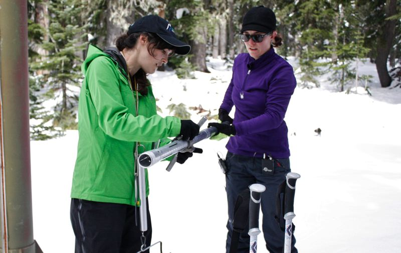POST PHOTO: KYLIE WRAY - Amy Burke, left, and Julie Koeberle, hydrologists with the Natural Resources Conservation Service, set their instruments to zero while preparing to measure snowpack.