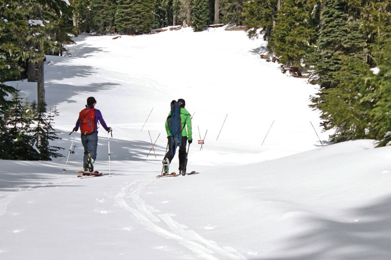 POST PHOTO: KYLIE WRAY - Julie Koeberle, left, and Amy Burke, hike a quarter mile into the Timberline ski area to the NCRS Mount Hood SNOTEL site.