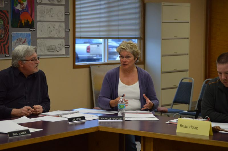 SPOTLIGHT PHOTO: MARK MILLER - Michelle Graham speaks during a meeting of the Scappoose School District's budget committee on Wednesday, April 15.