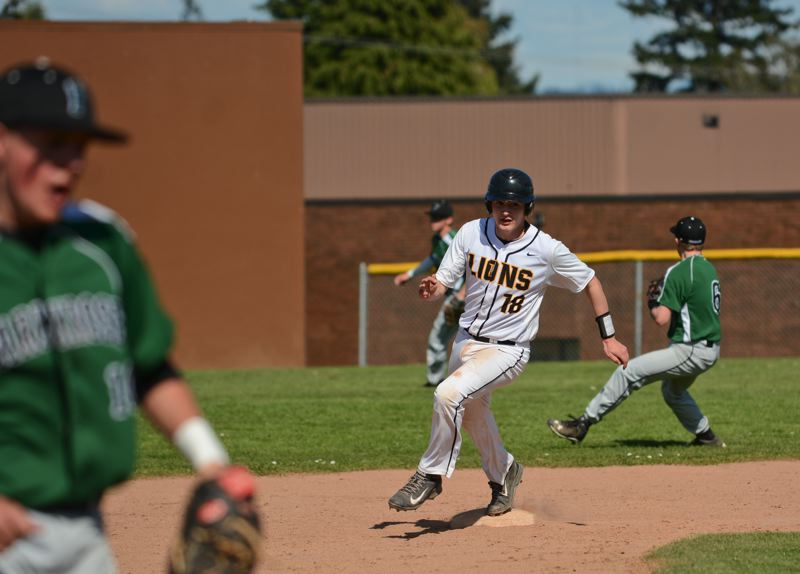 JOHN WILLIAM HOWARD - St. Helens' Bryce Winnier rounds second base early in the Lions' first game against Parkrose on Friday afternoon.