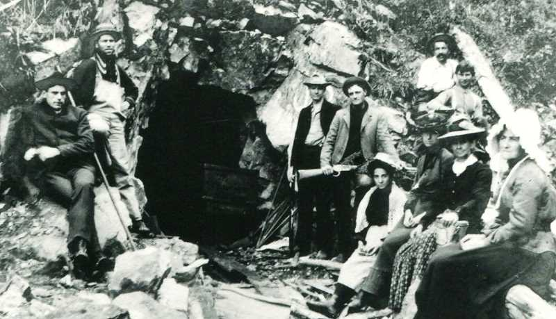 CONTRIBUTED PHOTO: BILL WHITE - The Northern Lights Mine, located in the hills south of Welches, in 1898. August Hornecker, who dug and worked this mine with his partner Alvin Meinig, is the gent in the white shirt on the top far right. This mine, one of several that were staked and explored at the turn of the last century in this area, was part of what was called the original Bonanza Claim. In more recent times it has been renamed the Bonanza Mine.