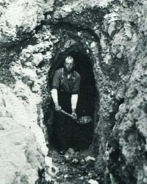 CONTRIBUTED PHOTO: BILL WHITE - C.W. (Lennie) Kern digging in his Cheeney Creek Mine south of Welches in 1903.