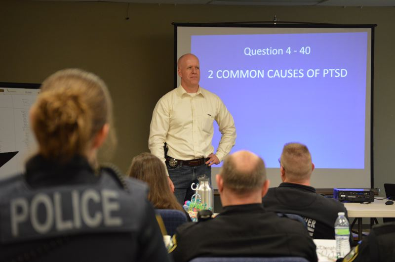 COURTNEY VAUGHN - St. Helens Police Chief Terry Moss leads a Jeopardy-style quiz game for law enforcement students Friday, April 24. The game was part of a week-long Crisis Intervention Training program for Columbia County police and sheriff's deputies.