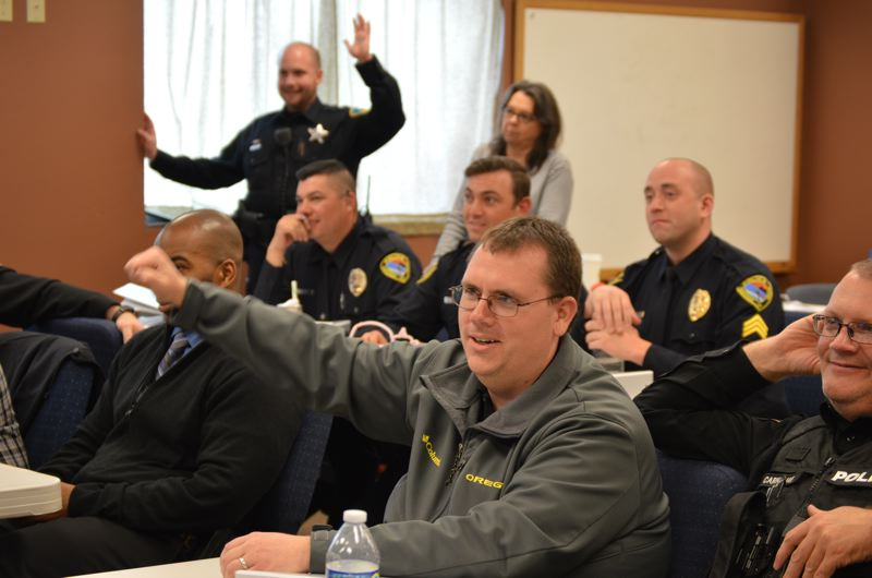 COURTNEY VAUGHN - Law enforcement officials respond to questions during a quiz-style game following a Crisis Intervention Team training in St. Helens Friday, April 24. The week-long training marked the first in Columbia County.