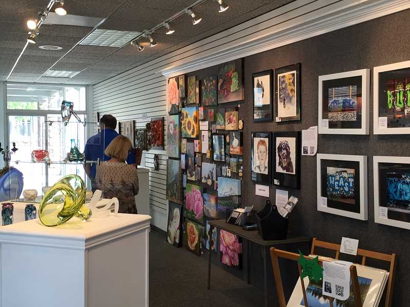 TIMES PHOTO: GEOFF PURSINGER - The pop up art gallery on Southwest Main Street is one of several new features to the art walk, which runs through May 15.