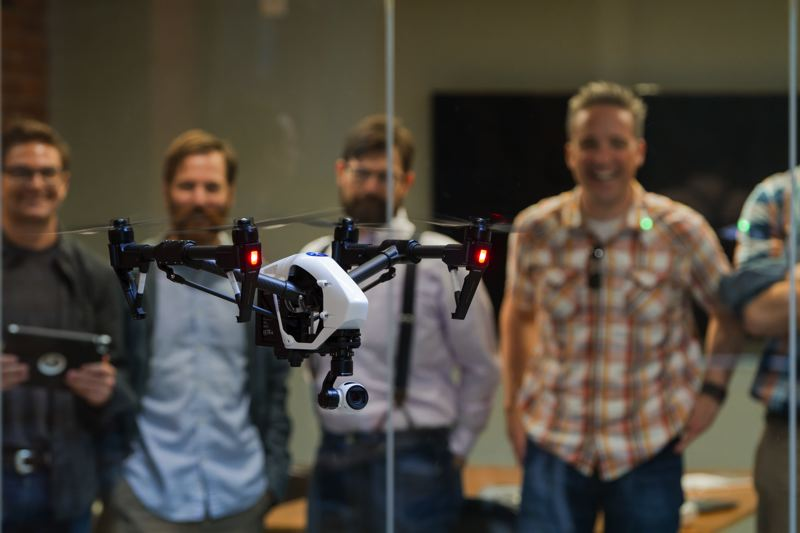 COURTESY JONATHAN NATIUK FOR SKYWARD - Skyward staff test a DJI Inspire 1 drone in their high celinged office on SW Naito Parkway. (L-R) Nick Wayne, Travis Widner, Andrew McCollough and CEO Jonathan Evans.