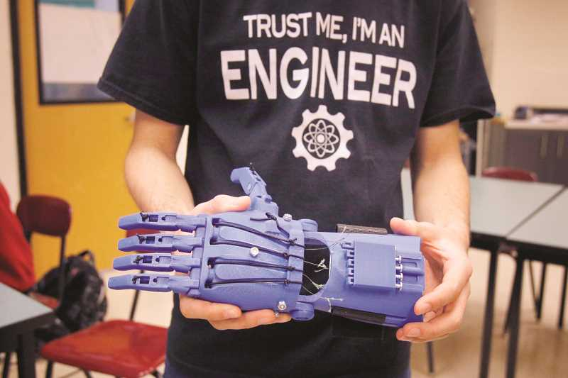 TIMES PHOTO: JONATHAN HOUSE - The hands that Southridge students are making with 3-D printers will be used by children in need around the world.
