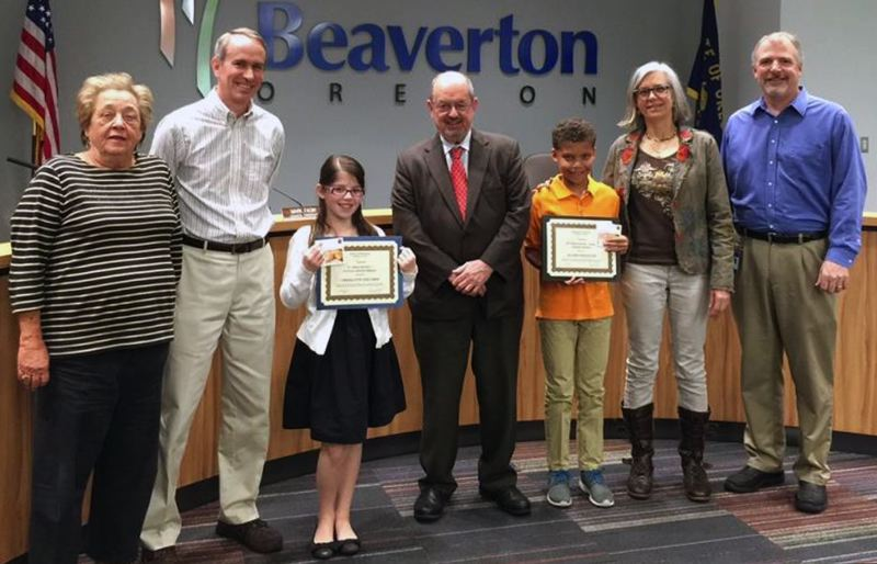 PHOTO COURTESY OF CITY OF BEAVERTON - The Beaverton City Council recognized the winners of the 2015 'If I Were Mayor' contest May 5. From left to right are Councilor Betty Bode, Councilor Marc San Soucie, poster contest winner Charlotte Balcher, Mayor Denny Doyle, essay contest winner Elijah Singleton, Councilor Cate Arnold and Council President Mark Fagin.