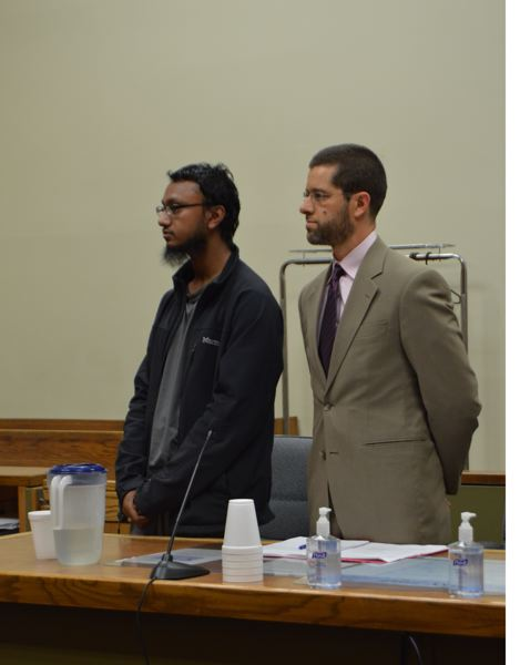 COURTNEY VAUGHN - MD Shahidul Islam, 26, stands next to his attorney, Yunus Paisner, in a Columbia County courtroom Tuesday during his sentencing hearing. Islam was ordered to comply with probation or face prison time.