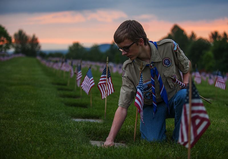 OUTLOOK PHOTO: JOSH KULLA - Gresham Boy Scout Alonzo Perry cleans a grave site at Willamette National Cemetery.