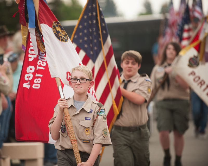OUTLOOK PHOTO: JOSH KULLA - Scouts with Troop 664 of the Greater Gresham Baptist Church carry the colors Thursday at Willamette National Cemetery.