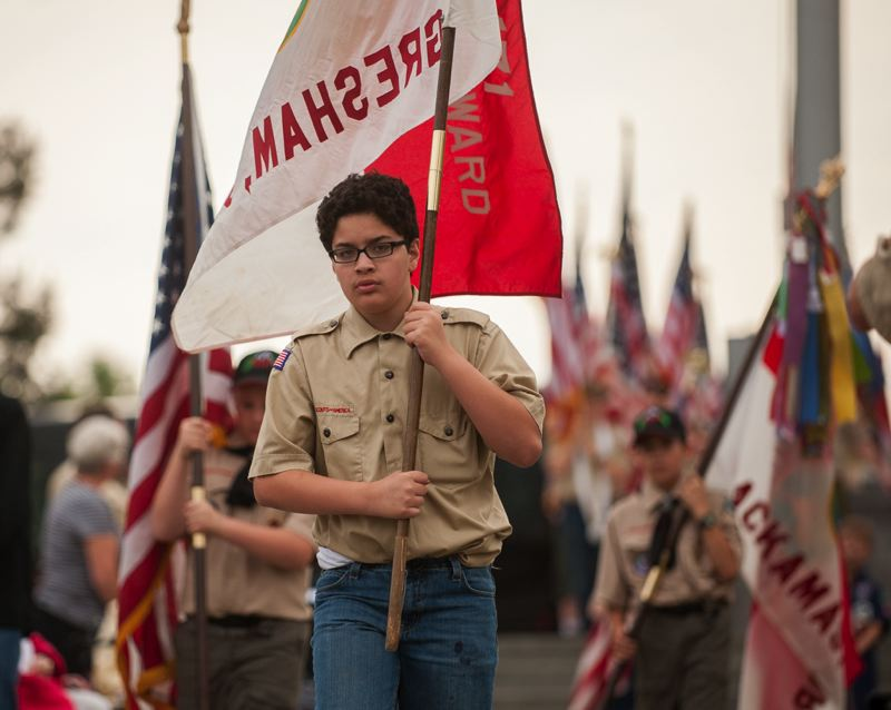 OUTLOOK PHOTO: JOSH KULLA - A Gresham Boy Scout carries his Troop's colors at Willamette National Cemetery.
