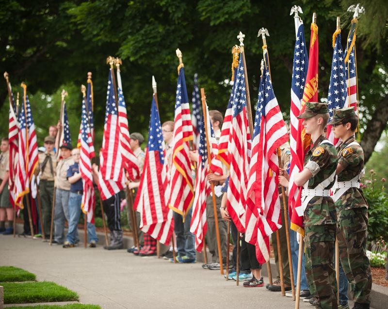 OUTLOOK PHOTO: JOSH KULLA - Thunderbird District Boy Scouts at Willamette National Cemetery Thursday.
