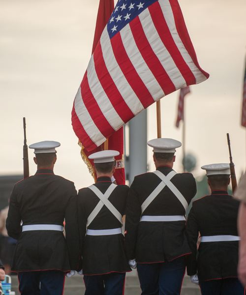 OUTLOOK PHOTO: JOSH KULLA - A U.S. Marine honor guard parades at Willamette National Cemetery Thursday.