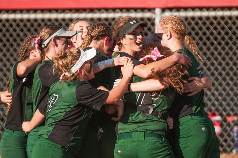 Reynolds players celebrate the final out in their 8-4 playoff win over Southridge.