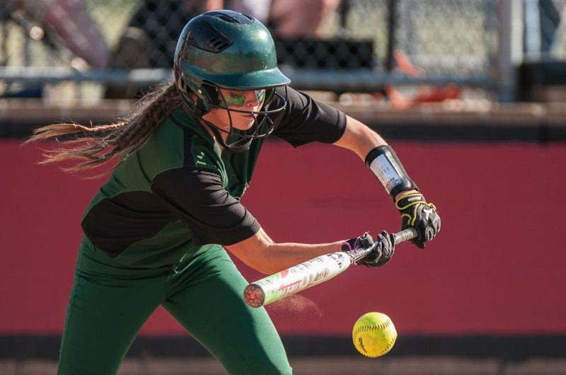A Reynolds batter lays down a bunt.
