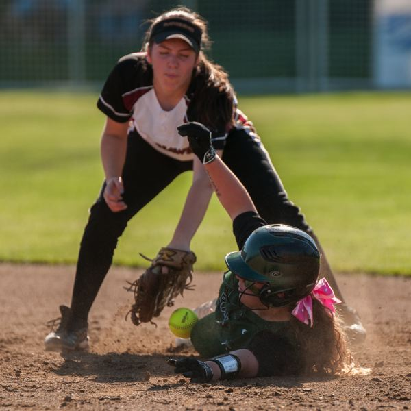 Cortney Curtis slides into second base as the ball is bobbled.