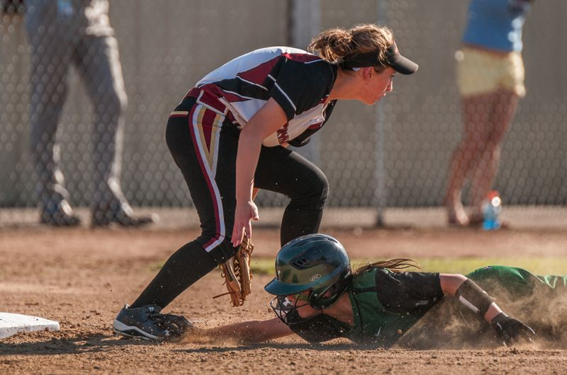 Alyssa Porter slides into third base as an errant throw heads into the outfield. She would go on to score.