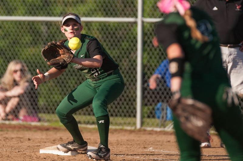 Reynolds infielder Emily Weidlich takes a throw at first base.