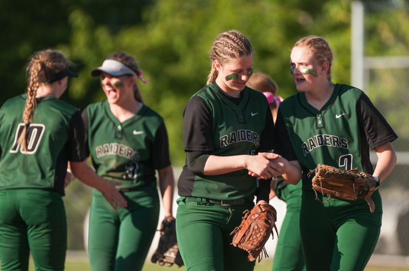 Alison Walton (front left) and Trisha Wilson celebrate a seventh inning out.