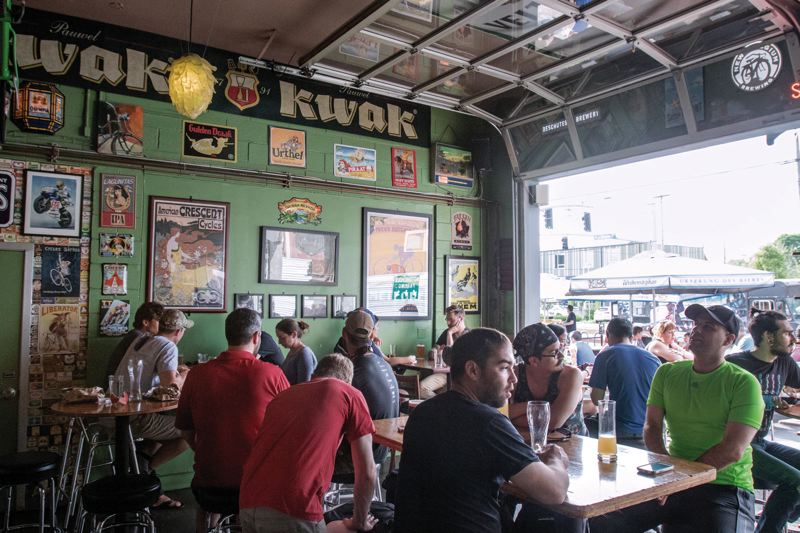TRIBUNE PHOTO: JONATHAN HOUSE - Apex Bar on Southeast Division Street fills up on warm afternoon. More sour beer, nonprofit pubs and other trends have popped up in the past year.