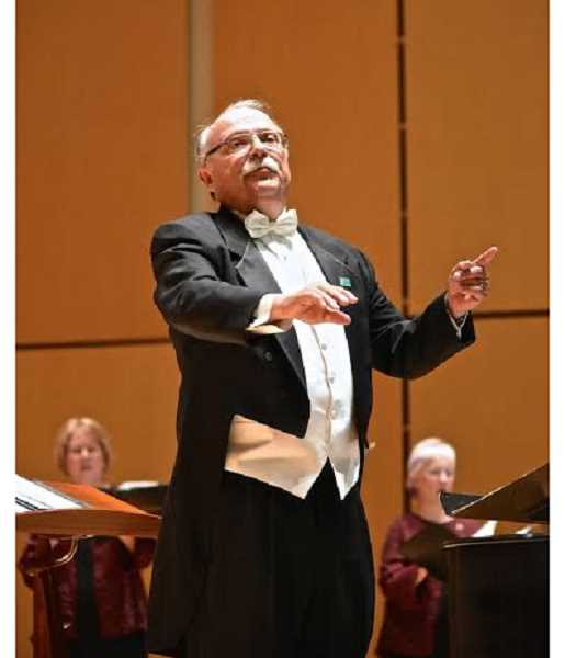 COURTESY PHOTO: DON WHITE - Bernie Kuehn conducts the Washington County-based Oregon Chorale a final time.