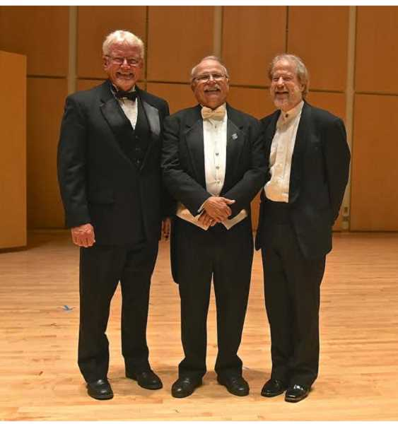 COURTESY PHOTO: DON WHITE - Composers Randal Spitzer and James A. Howland wrote a special song for retiring Oregon Chorale conductor Bernie Kuehn (center), which was performed June 7 during a 'Bye, bye Bernie' concert in Forest Grove.