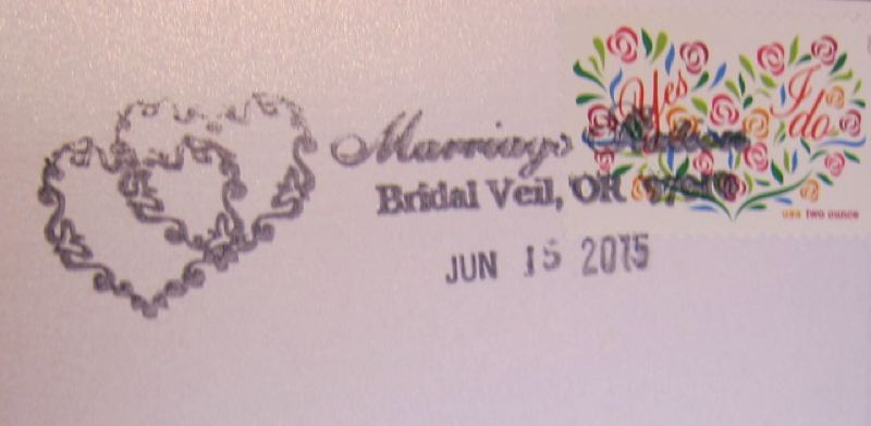 CONTRIBUTED PHOTO: QUINTON SMITH - Wedding mail is stamped by hand with a special cancellation showing intertwined hearts or doves.