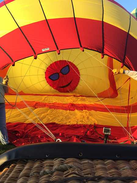 TIMES PHOTO: GEOFF PURSINGER - The inside of Brann Smith's balloon is a bit different from other pilots. His balloon, Sundancer, flew from Cook Park to Woodburn on Friday morning