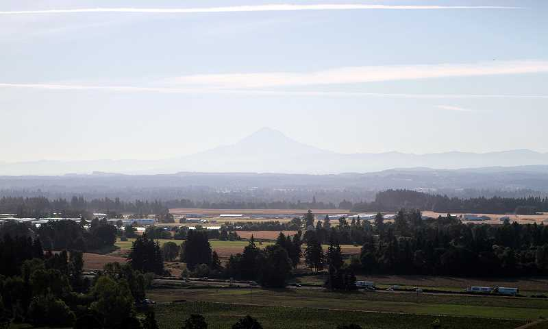 TIMES PHOTO: MILES VANCE - Vance caught this photo of early morning Mt. Hood, which shimmers in the distance.