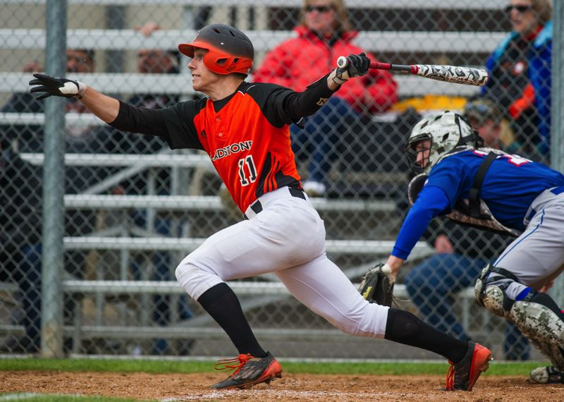 JOHN LARIVIERE - Ben Fox, pictured here in a 2015 Tri-Valley Conference game with Madras, hit up a storm in 2015. The talented outfielder led the Gladiators with a .488 batting average, as they had one of their most successful seasons in school history.