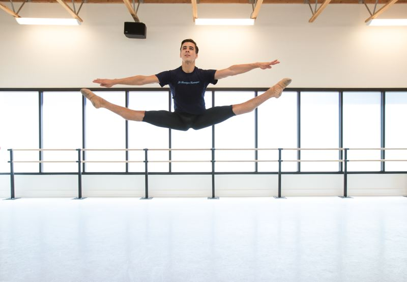 TIMES PHOTO: JONATHAN HOUSE - Arts & Communication Magnet Academy graduate Nick Jurica warms up with some jumps at The Portland Ballet.