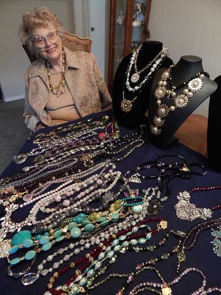 TIDINGS PHOTO: CLIFF NEWELL - Betty Breitbarth has an amazing display of necklaces on a table in her own home in West Linn. Now she wants to put her necklaces in womans apparel stores.