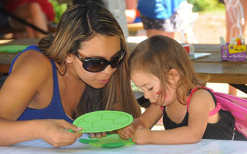 REVIEW PHOTOS: VERN UYETAKE - Sondra Bittner of Lake Oswego and her daughter Addilyn, 2, work on an art project at the Kids Get Creative activities on Friday.