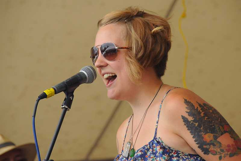 REVIEW PHOTOS: VERN UYETAKE - Jasmine VanDemarr performs Saturday afternoon with Anita Margarita and the Rattlesnakes at George Rogers Park.