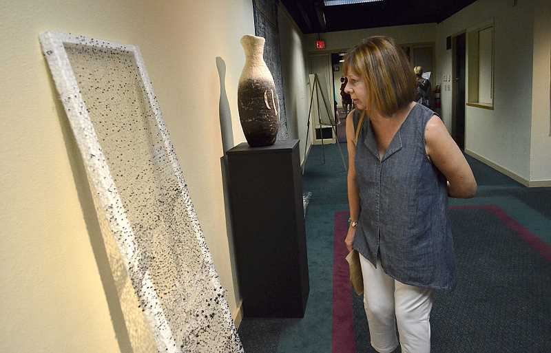 REVIEW PHOTOS: VERN UYETAKE - Teresa Buettner checks out the special exhibit at the Lakewood Center for the Arts.